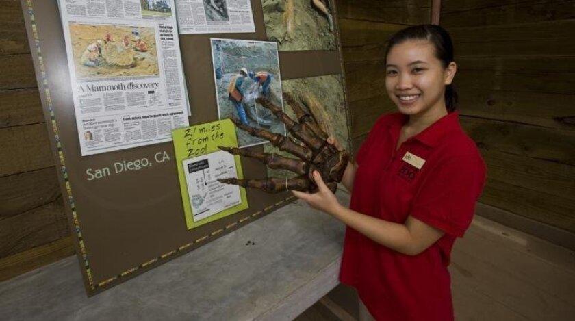A San Diego Zoo volunteer explains an exhibit.