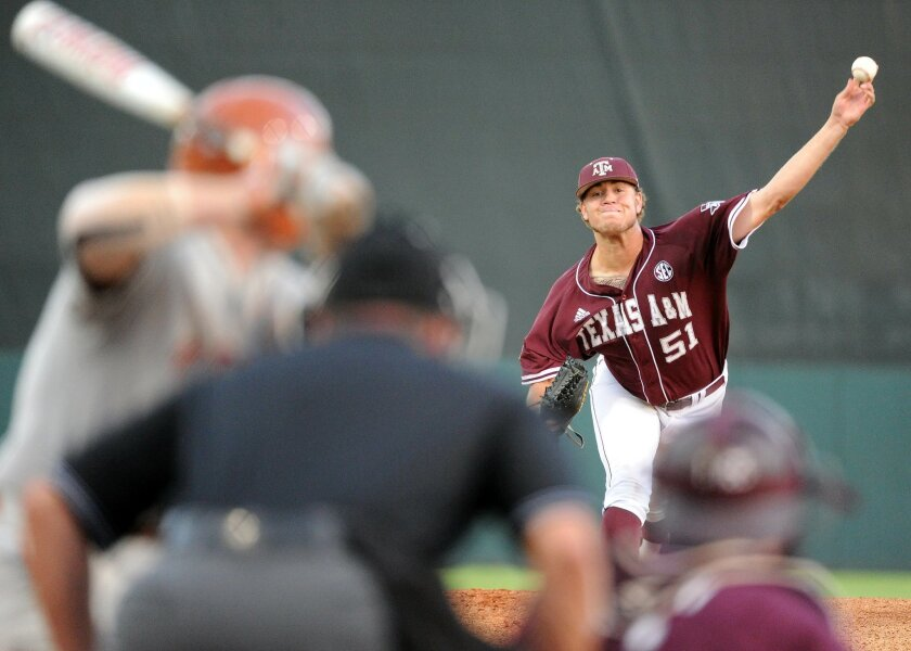 Texas A&M's Tyler Stubblefield delivers a pitch during the first inning of an NCAA baseball regional baseball game against Texas, Sunday, June 1, 2014, at Reckling Park in Houston. (AP Photo/Houston Chronicle, Eric Christian Smith)
