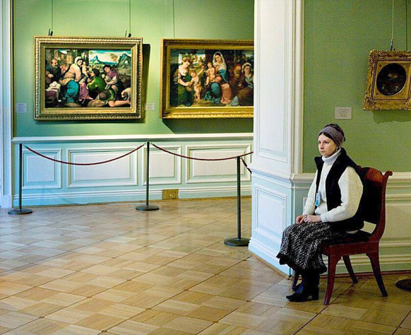 "Andy Freeberg's portrait series ""Guardians,"" at the Kopeikin Gallery in West Hollywood through April 17, captures female guards as they sit next to great works of art in Russian museums."