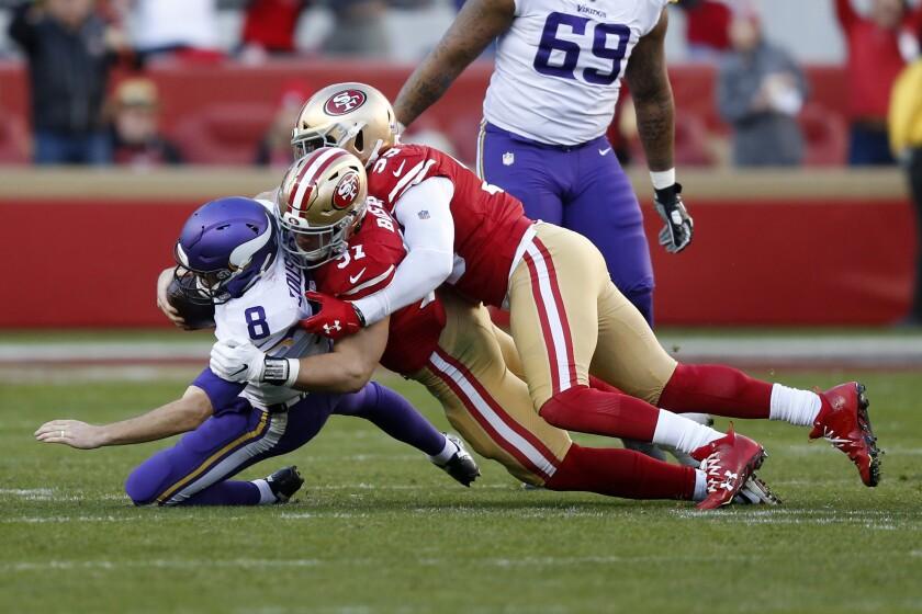 49ers defensive end Nick Bosa (97) brings down Vikings quarterback Kirk Cousins for a sack Jan. 11, 2020.