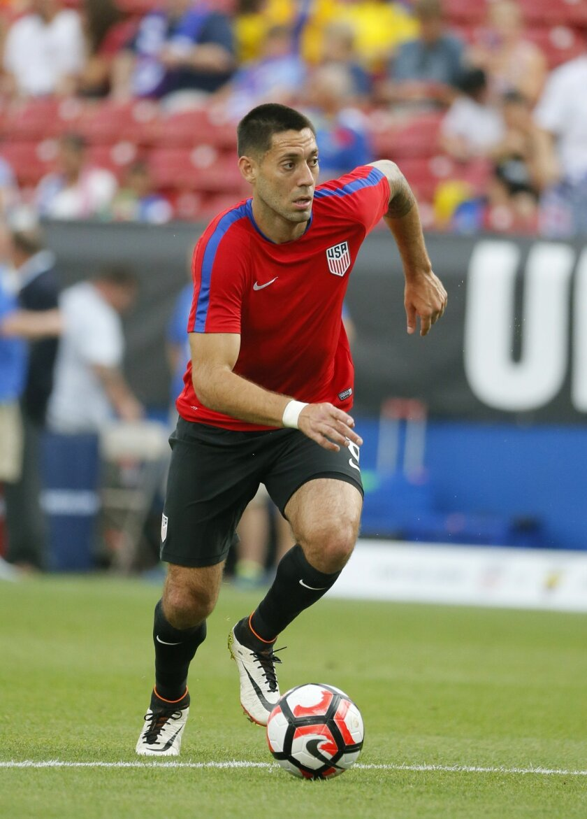 U.S. forward Clint Dempsey warms up for the team's exhibition soccer match against Ecuador, Wednesday, May 25, 2016, in Frisco, Texas. (AP Photo/Tony Gutierrez)