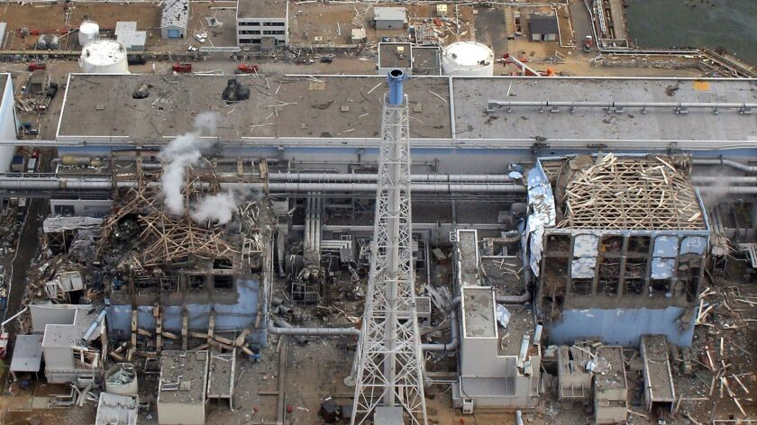 This file picture taken by an unmanned aerial vehicle on March 20, 2011 shows the stricken Tokyo Electric Power Company Fukushima Dai-Ichi nuclear power plant reactor 3 (left) and 4 (right).
