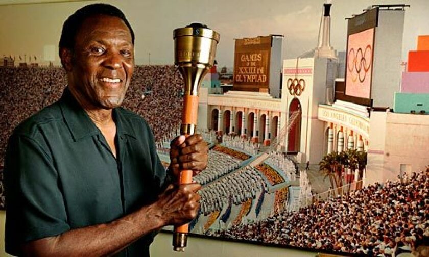 Rafer Johnson lit the Olympic flame at the opening of the 1984 Summer Games in Los Angeles.