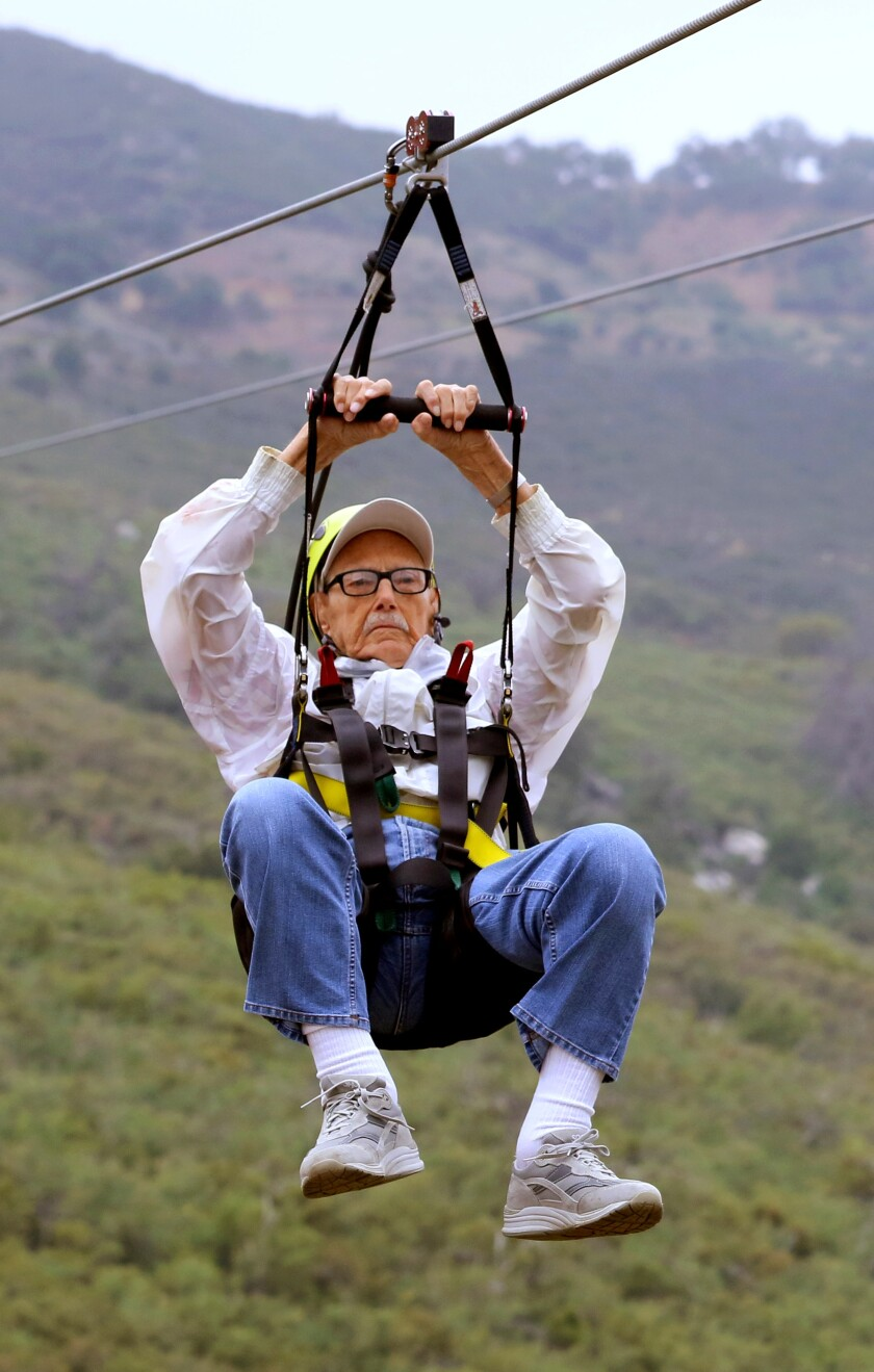 102 year old Glenn Quillin rides one of the three zip lines at La Jolla Zip Zoom at the La Jolla Indian Reservation.