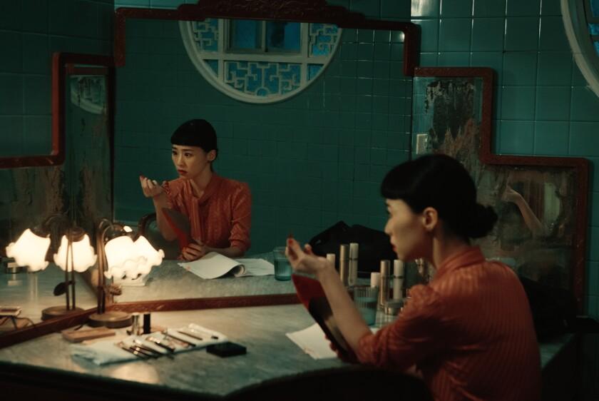 """Wu Ke-Xi sits before a mirror in the movie """"Nina Wu."""""""