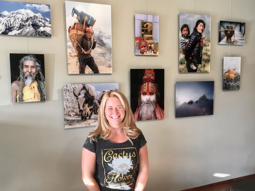 Briana Gallo poses in front of her photos.