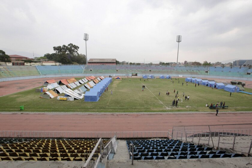In this Saturday, May 16, 2015 photo, makeshift tents for earthquake survivors are set up at Dasharath Stadium in Kathmandu, Nepal. Two recent earthquakes killed more than 8,300 people and have had a devastating impact on all aspects of life in Nepal, including sports. A revered national volleyball coach is among the thousands of dead, trapped in his rented house when devastating earthquakes rocked Nepal. The national football stadium venue was damaged, before becoming a makeshift refuge for displaced survivors of the quakes. The cricket team's preparations for an elite international tournament next year are disarray. (AP Photo/Niranjan Shrestha)