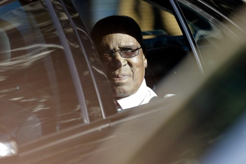 Andrew Mlangeni en route to visit former South African President Nelson Mandela in 2013