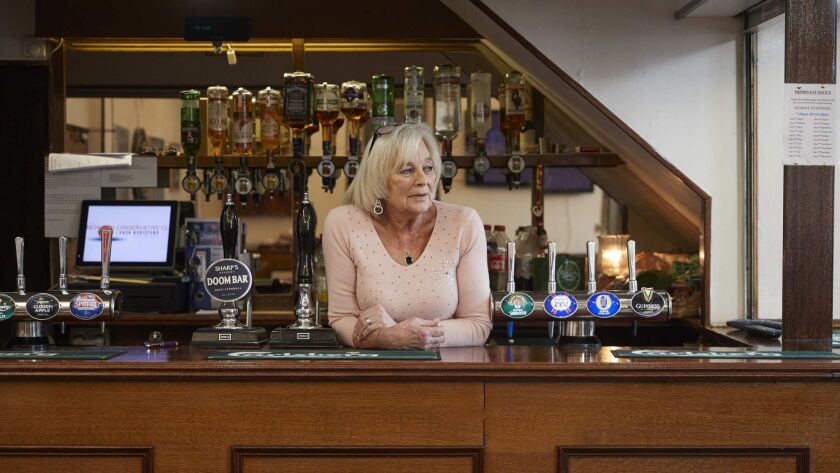 HORNCHURCH, ENGLAND - APRIL 13: Joann Peake, 78, bartender at Hornchurch Conservative Club. Joann vo