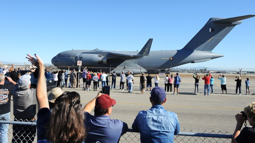 A crowd watches as the final Boeing C-17 Globemaster III cargo plane built at the company's Long Beach plant taxis at the Long Beach Airport before departure on Sunday.