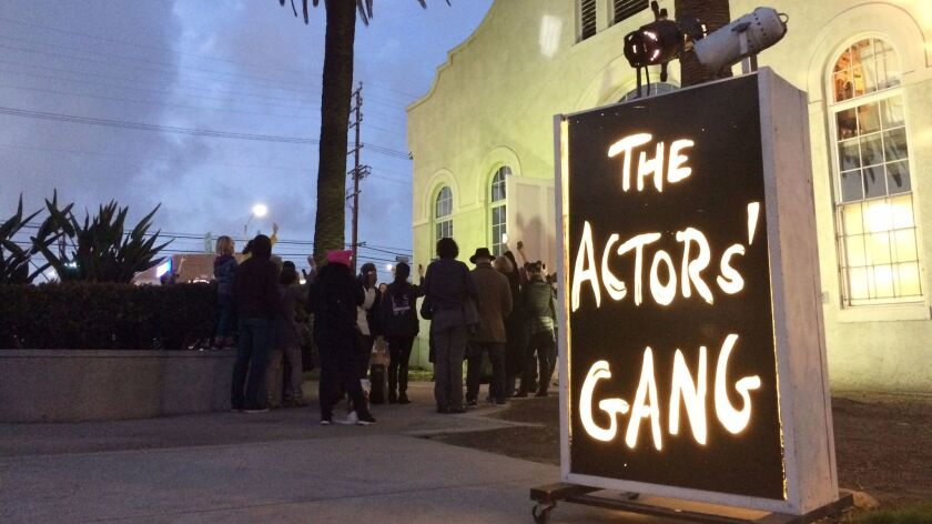 """Members of the Actors' Gang in Culver City gather in front of the theater on Jan. 19, the eve of Donald Trump's inauguration, to turn on a """"ghostlight"""" as a gesture of tolerance."""