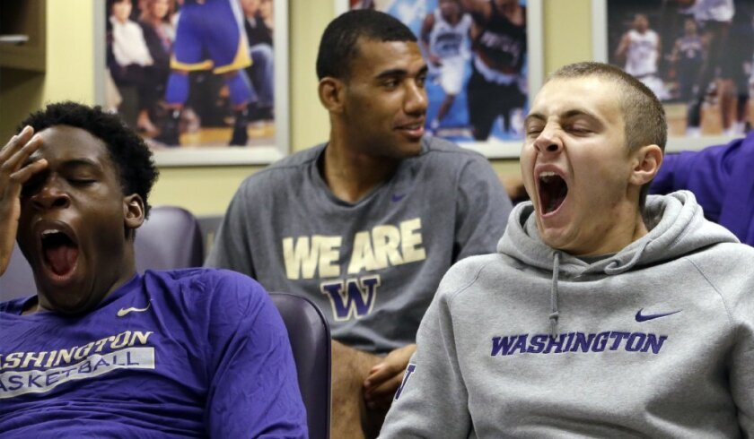 Members of the University of Washington basketball team yawn during a class on Chinese culture. A new study reveals our preindustrial ancestors didn't get eight hours of sleep at night either.