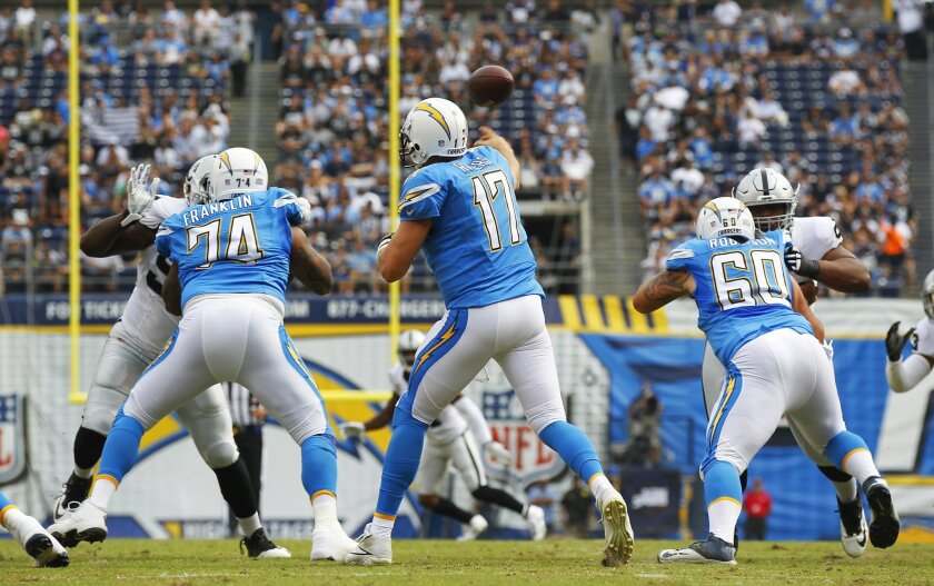 Chargers Philip Rivers throws an interception to Raiders Malcolm Smith in the 1st quarter.