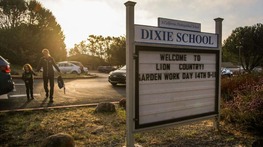 The sign for Dixie Elementary School is seen at the entrance to the school in San Rafael. Dixie Scho
