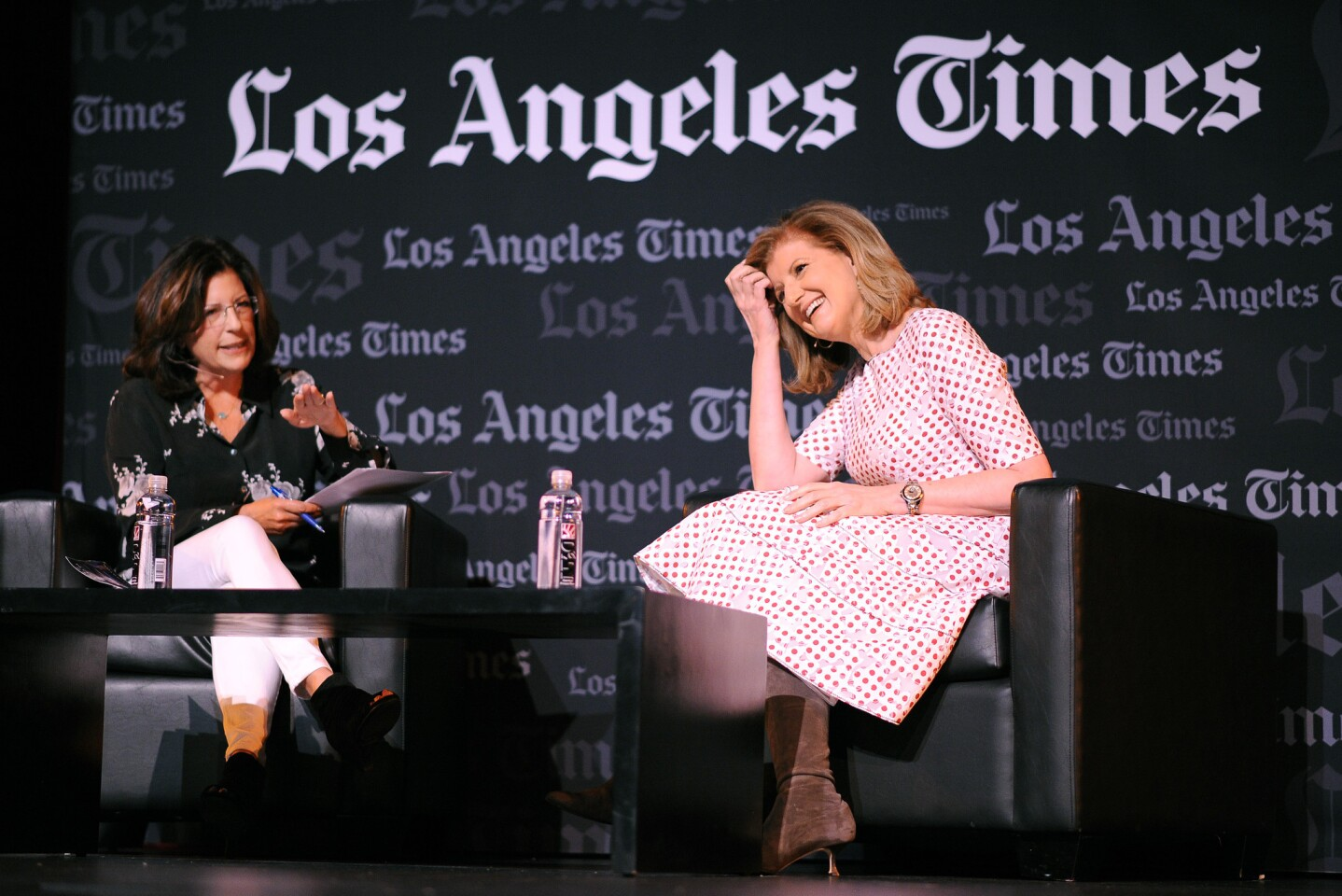 Arianna Huffington, right, chats with Times columnist Robin Abcarian at the Festival of Books at USC's Bovard Auditorium.