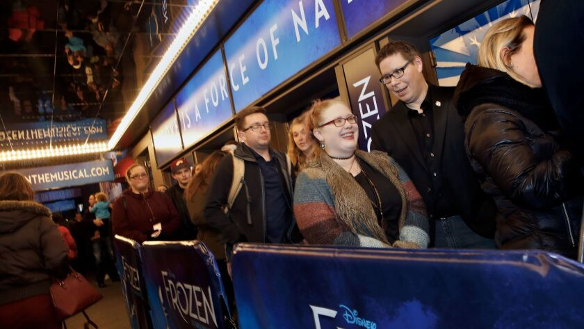 "Fans line up for the first preview of the musical ""Frozen"" at the St. James Theatre in New York."