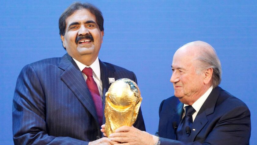 Sheikh Hamad bin Khalifa Al-Thani, then the emir of Qatar, and then-FIFA President Sepp Blatter, after the announcement that Qatar would be the 2022 World Cup host.