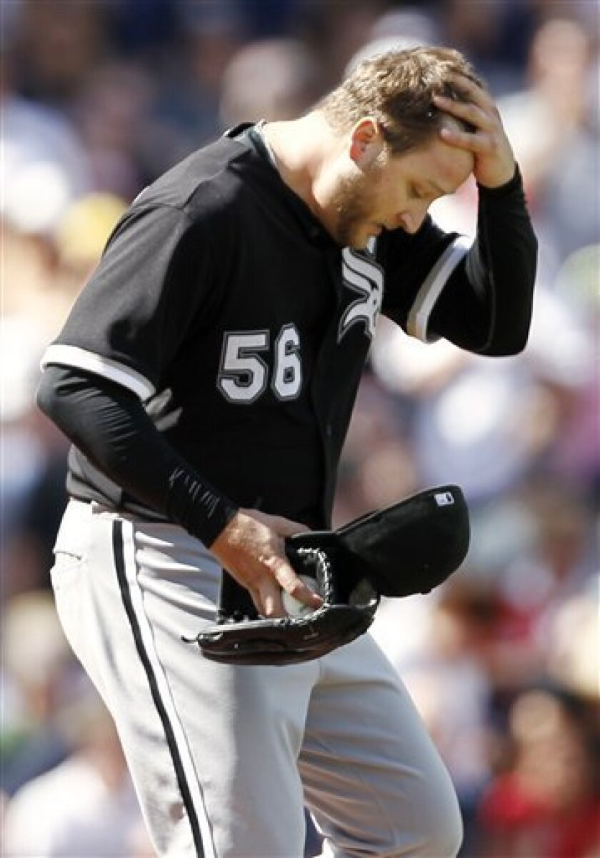 Chicago White Sox starting pitcher Mark Buehrle walks back to the mound after giving up the lead during the seventh inning of a baseball game against the Boston Red Sox at Fenway Park in Boston on Sunday, Sept. 5, 2010. (AP Photo/Winslow Townson)