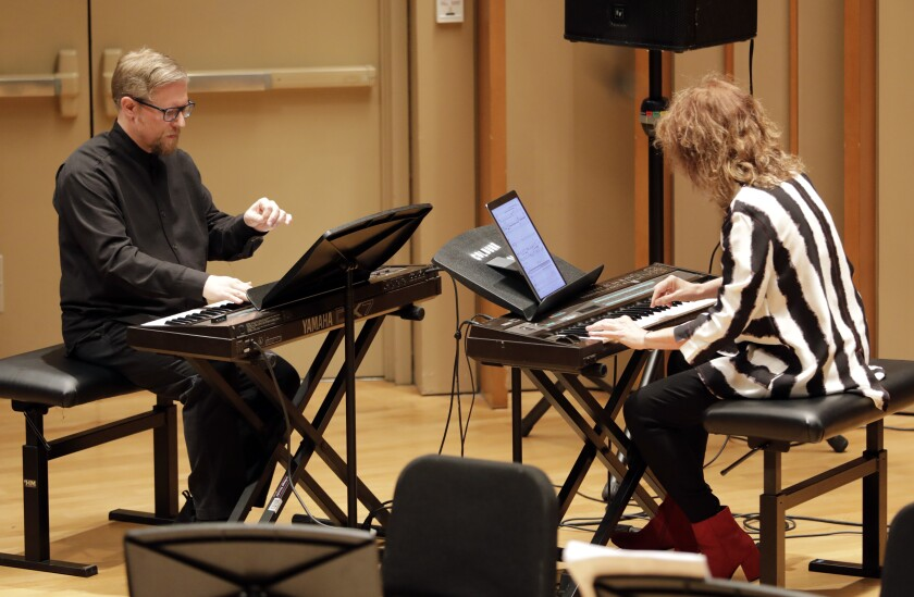"Aron Kallay and Vicki Ray perform ""Atlantys"" by Tristan Murail during the Piano Spheres concert."