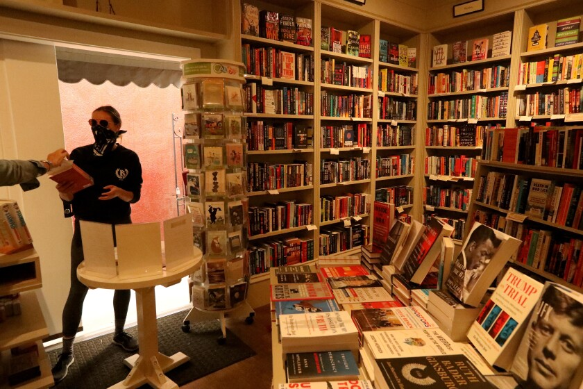 Bookseller Mia Wigmore, left, helps customer Olivia Janisch at the Diesel, A Bookstore in Brentwood.