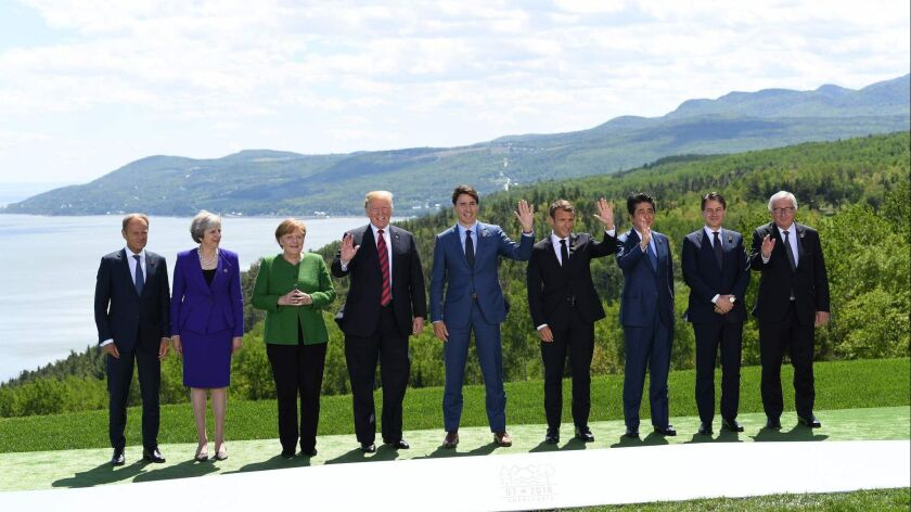 "The leaders of the Group of 7 major economic powers, along with the heads of the European Council and the European Commission, pose for a traditional ""family photo"" during their summit in La Malbaie, Quebec, Canada, on Friday."