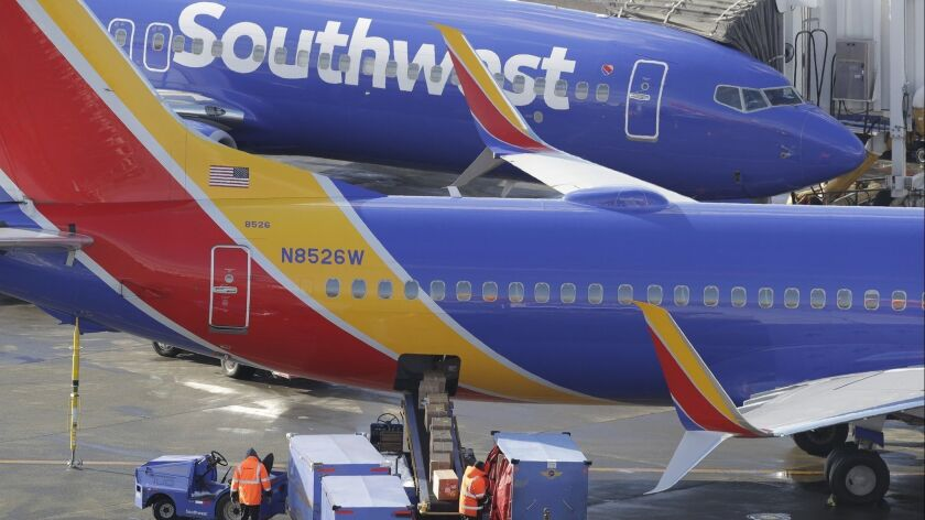 Southwest Airlines planes are loaded Tuesday, Feb. 5, 2019, at Seattle-Tacoma International Airport