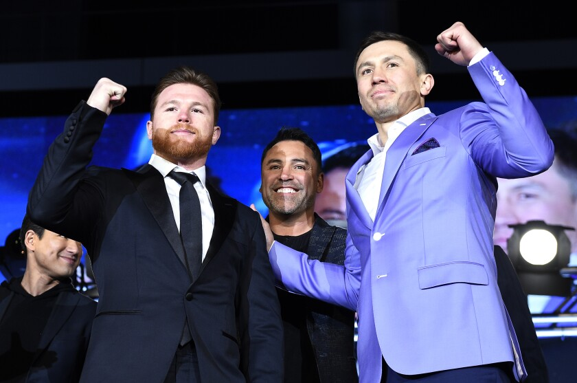 Canelo Alvarez, left, promoter Oscar De La Hoya, center, and Gennady Golovkin pose during a news conference in February 2018.