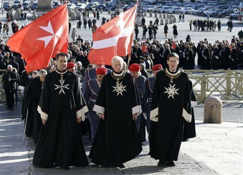 Members of the Knights of Malta walk in procession towards St. Peter's Basilica during a celebration to mark the 900th anniversary of the Order of the Knights of Malta, at the Vatican, Saturday, Feb. 9, 2013. The order traces its history to the 11th century with the establishment of an infirmary in