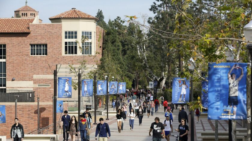 FILE - In this Feb. 26, 2015, file photo, students walk on the University of California, Los Angeles