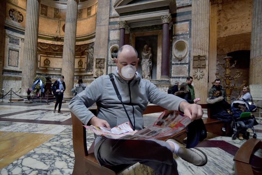 A masked tourist at Rome's Pantheon