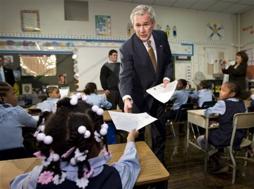President George W. Bush collects letters from pupils during a visit to the General Philip Kearny School in Philadelphia, Thursday, Jan. 8, 2009, to mark the anniversary of his No Child Left Behind law.  (AP Photo/J. Scott Applewhite)