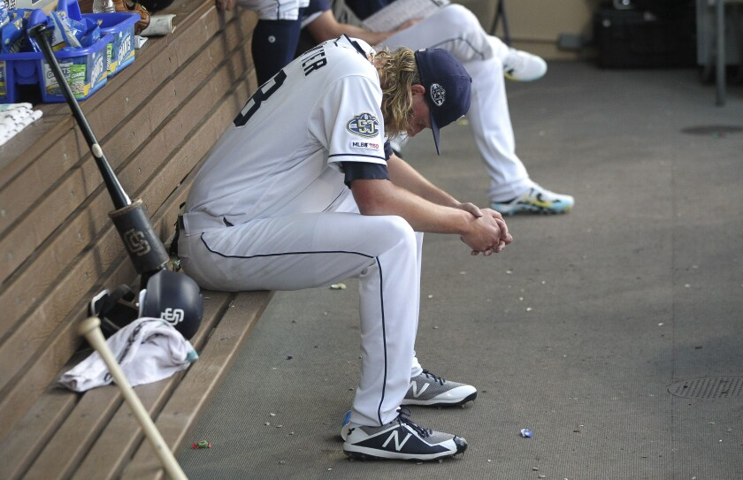Padres pitcher Trey Wingenter sits in the dugout after he was pulled from Wednesday's game against the Dodgers.