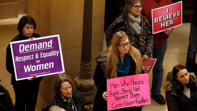Women rally Friday, Nov. 17, 2017 at the State Capitol in St. Paul, Minn., in response to a tide of