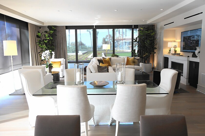 The New Home Company unveiled Meridian, its new development of luxury condos, last month. So far 40 out of 79 units, which are priced from $3 million to $4 million have sold. The spacious living room and kitchen area are one space in unit shown above.