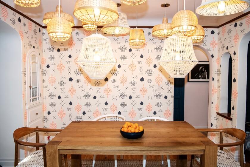 Multiple basket-covered pendants create a stunning lighting arrangement.