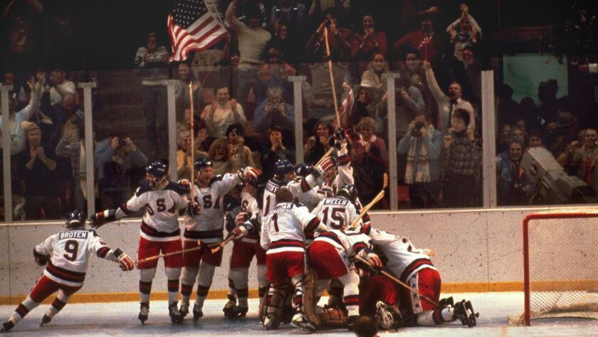 The U.S. hockey team pounces on goalie Jim Craig after a 4-3 victory against the Soviets in the 1980