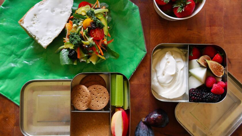 Inside chefs Suzanne Goin and David Lentz's kids lunch boxes is a veggie sandwich with goat cheese,