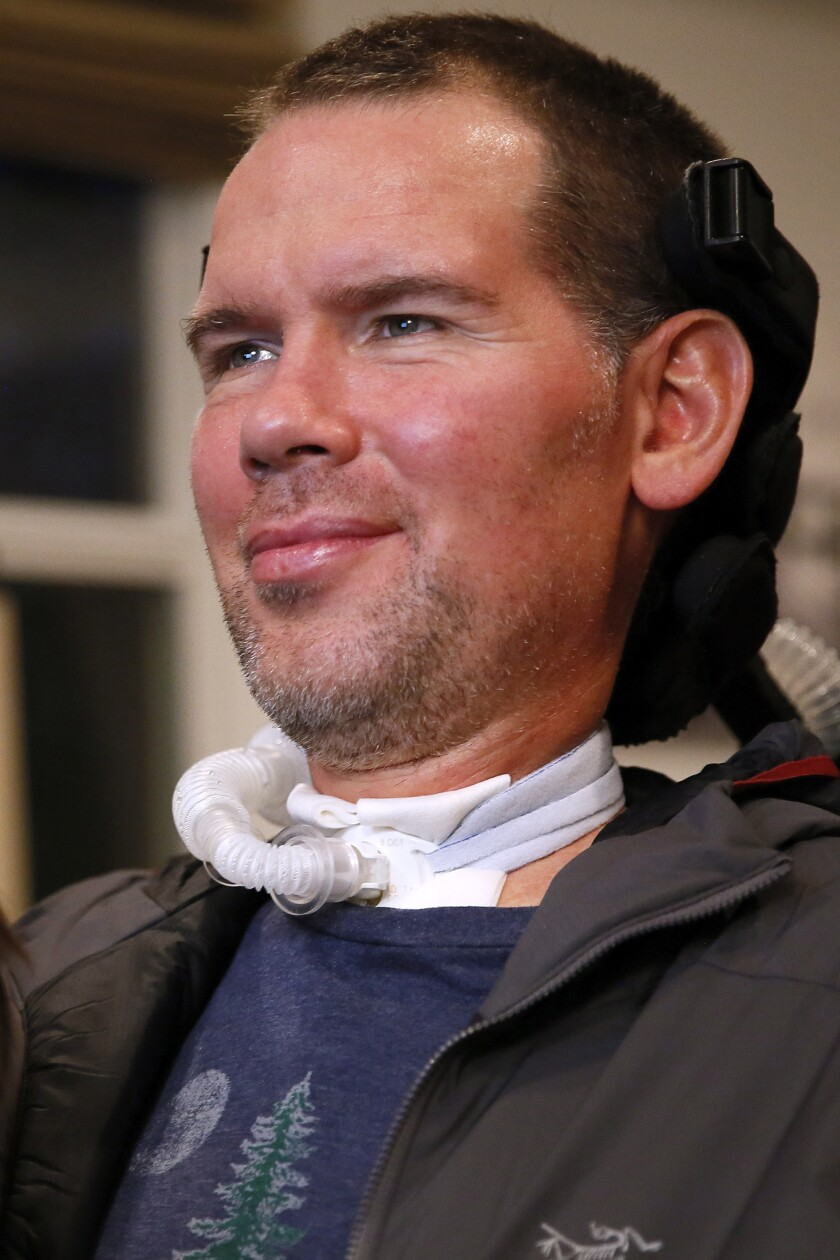 FILE - In this Monday, Jan. 18, 2016, file photo, former New Orleans Saints NFL football player Steve Gleason is shown during an interview in New Orleans. Gleason, who become a leading advocate for people struggling with Lou Gehrig's disease after he was diagnosed with the paralyzing condition, will be awarded the Congressional Gold Medal during a ceremony on Jan. 15. President Donald Trump signed legislation last year awarding Gleason the medal, which is the highest civilian honor awarded by Congress. (AP Photo/Jonathan Bachman, File)