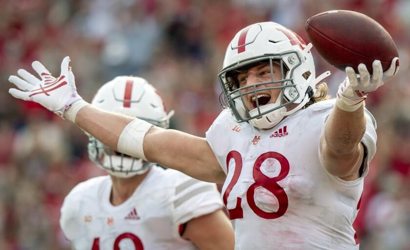 Nebraska linebacker Luke Reimer (28) celebrates his fourth-quarter interception against Buffalo in an NCAA college football game Saturday, Sept. 11, 2021, in Lincoln, Neb. (Francis Gardler/Lincoln Journal Star via AP)