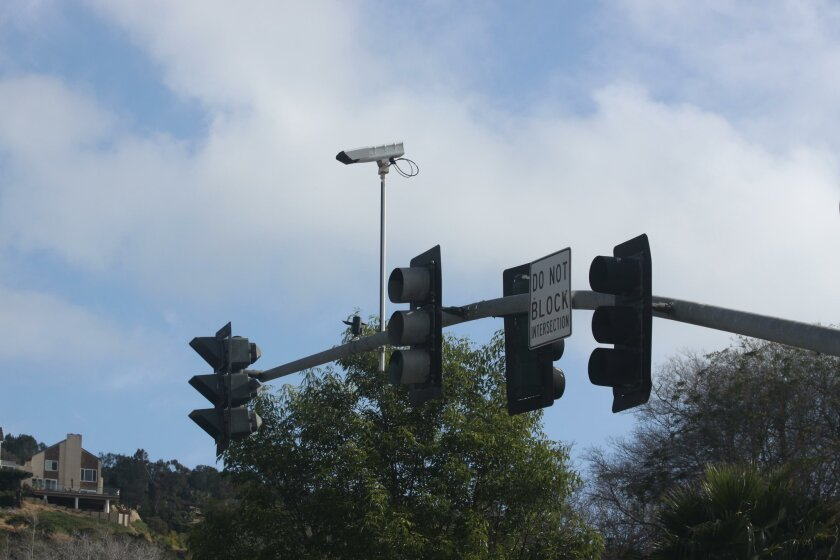 The adaptive signal timing cameras are perched above mast arms over La Jolla Parkway's busy intersections.