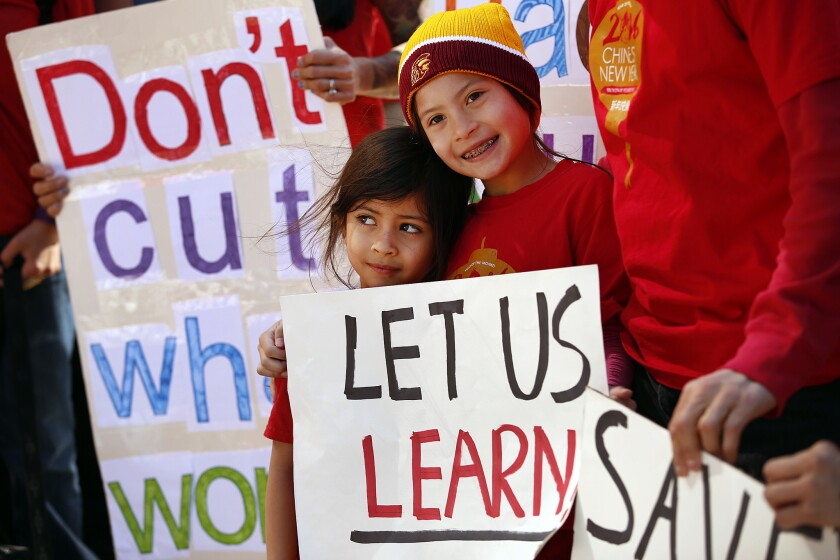Los Angeles Unified School District students Alexandria Marek, 8, right, and Kerala Seth, 4, left, protested the district's cuts to the high-profile Mandarin Immersion Program at Venice's Broadway Elementary school in March.