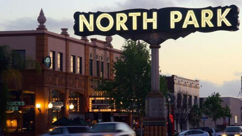 The iconic North Park sign hanging above University Avenue. (DiscoverSD)