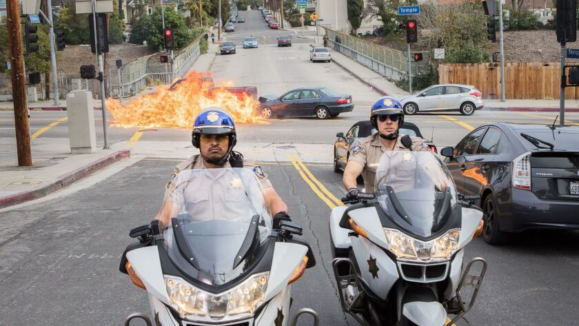 """The streets of L.A. get a workout with Michael Peña, left, and Dax Shpeard in """"CHIPS."""""""