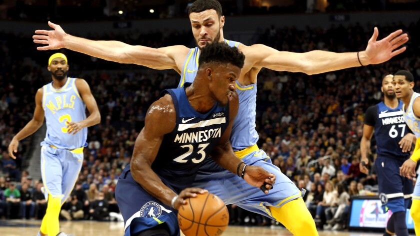 Lakers forward Larry Nance Jr. tries to cut off a drive by Timberwolves guard Jimmy Butler during their Jan. 1 game in Minneapolis.