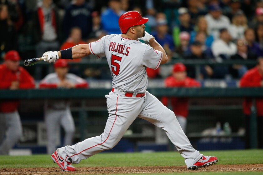 Albert Pujols says he's found a key to fixing his swing, but he won't say what it is