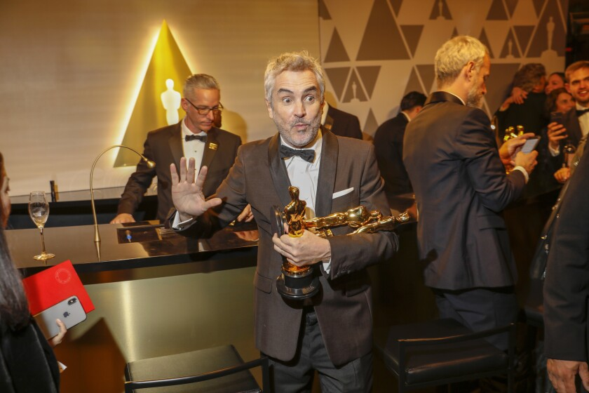 Alfonso Cuarón with his three Oscars at the Academy Awards Governors Ball on Sunday night.