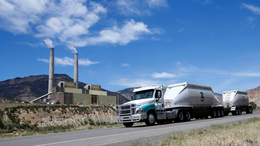 A coal truck leaves the Huntington Power plant outside Huntington, Utah, this month.