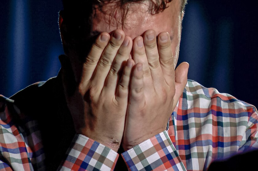 """In this grab taken from video released by Belarusian state-controlled ONT Channel on Thursday, June 3, 2021, dissident journalist Raman Pratasevich gestures as he cries during his interview with Belarusian ONT Channel in Minsk, Belarus. Belarusian opposition activists say that a dissident journalist has been coerced to appear in a video on state TV in which he wept and praised the country's authoritarian ruler. In the 90-minute video aired Thursday night, 26-year-old Raman Pratasevich repented for his opposition activities and said he respects Belarus' President Alexander Lukashenko as """"a man with balls of steel."""" (ONT channel via AP)"""