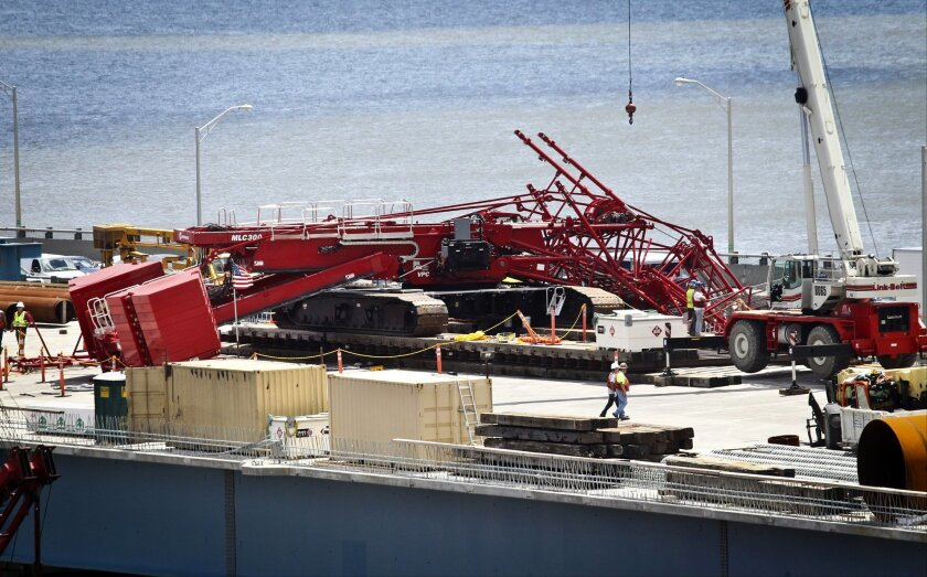 A construction crane is sprawled across lanes in both directions after collapsing on the Tappan Zee Bridge, Tuesday July 19, 2016, in New York. (Peter Carr/The Journal News via AP)
