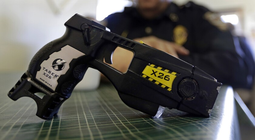 FILE - This Nov. 14, 2013, file photo, shows a Taser X26 on display. Shares in Axon Enterprises, the